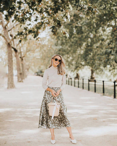 beige sweater and printed skirt