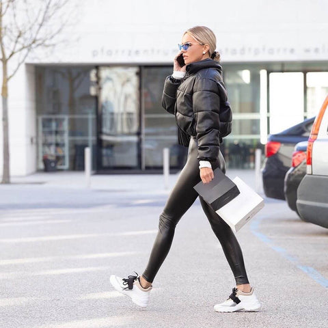 leather leggings and sneakers