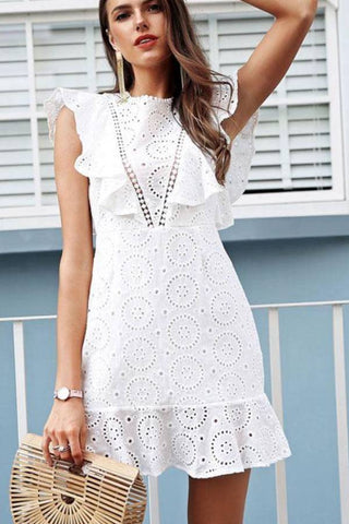 Fashion blog: 12 cute birthday outfits for women - woman wearing sleeveless lace mini dress