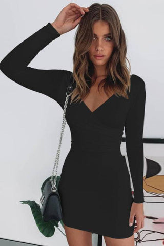 Fashion blog: 11 Cute birthday outfits for women - woman wearing long sleeve bodycon wrap dress