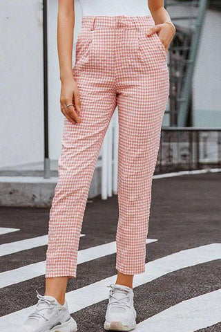 Fashion blog: The most popular color to wear this spring - woman wearing plaid high waist pencil pants