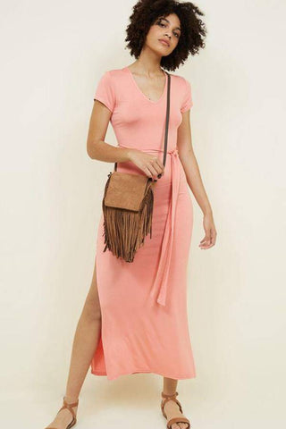 Fashion blog: The most popular color to wear this spring - woman wearing pink short sleeve midi dress