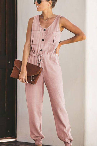 Fashion blog: The most popular color to wear this spring - woman wearing pink sleeveless buttoned jumpsuit