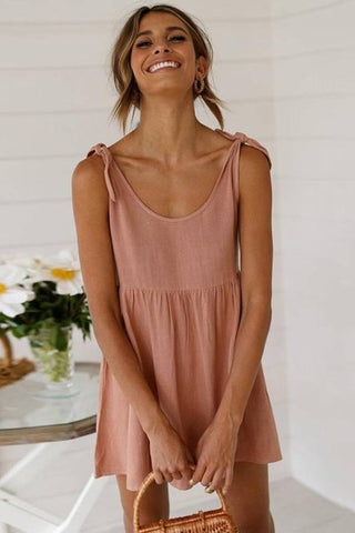 Fashion blog: The most popular color to wear this spring - woman wearing pink round collar mini slip dress