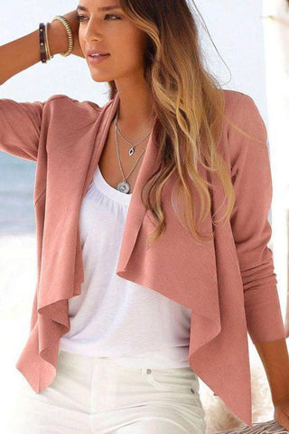 Fashion blog: The most popular color to wear this spring - woman wearing pink irregular hemline jacket