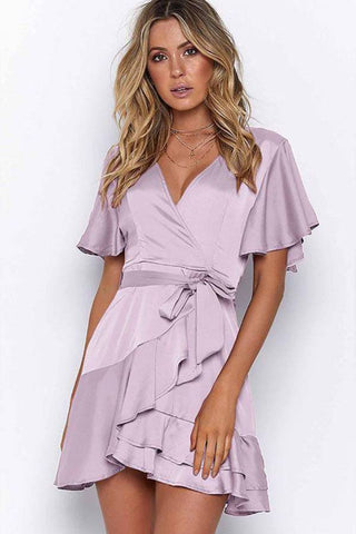 Fashion blog: 11 Cute birthday outfits for women - woman wearing short sleeve mini wrap dress