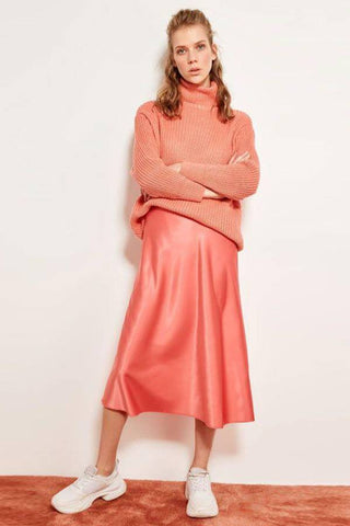 Fashion blog: The most popular color to wear this spring - woman wearing knee length pink skirt