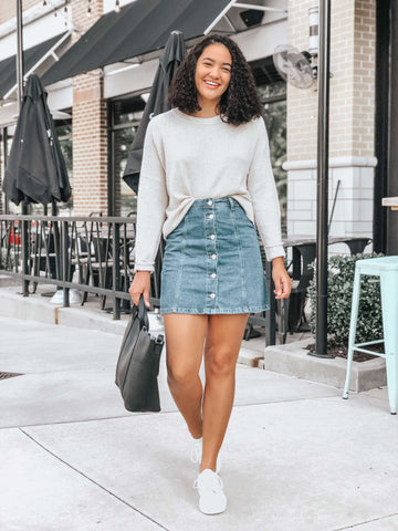 beige sweater and denim skirt