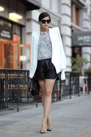 white blazer and black leather shorts