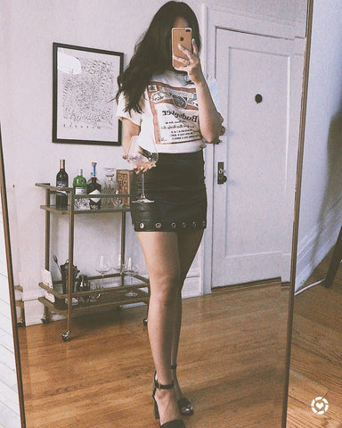 graphic tee with leather skirt