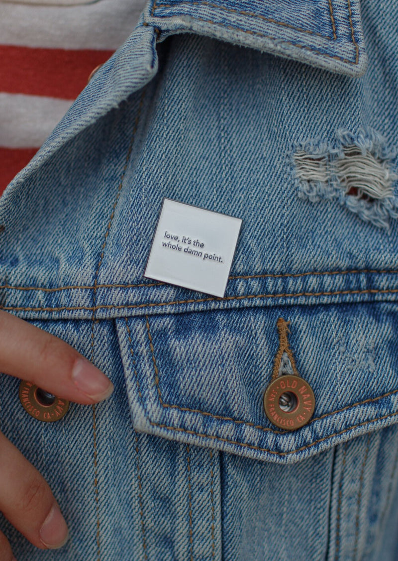 """love, it's the whole damn point."" lapel pin"