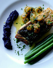 Photograph of low FODMAP oven baked barramundi steaks with a shrimp & burnt butter sauce, sautéed green beans and a parenthesis of purple heirloom carrot purée.