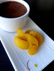 Photograph of low FODMAP chilli chocolate pots with champaign & saffron poached mandarin