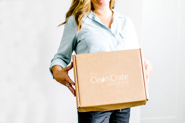 Women holding a Clean Crate box