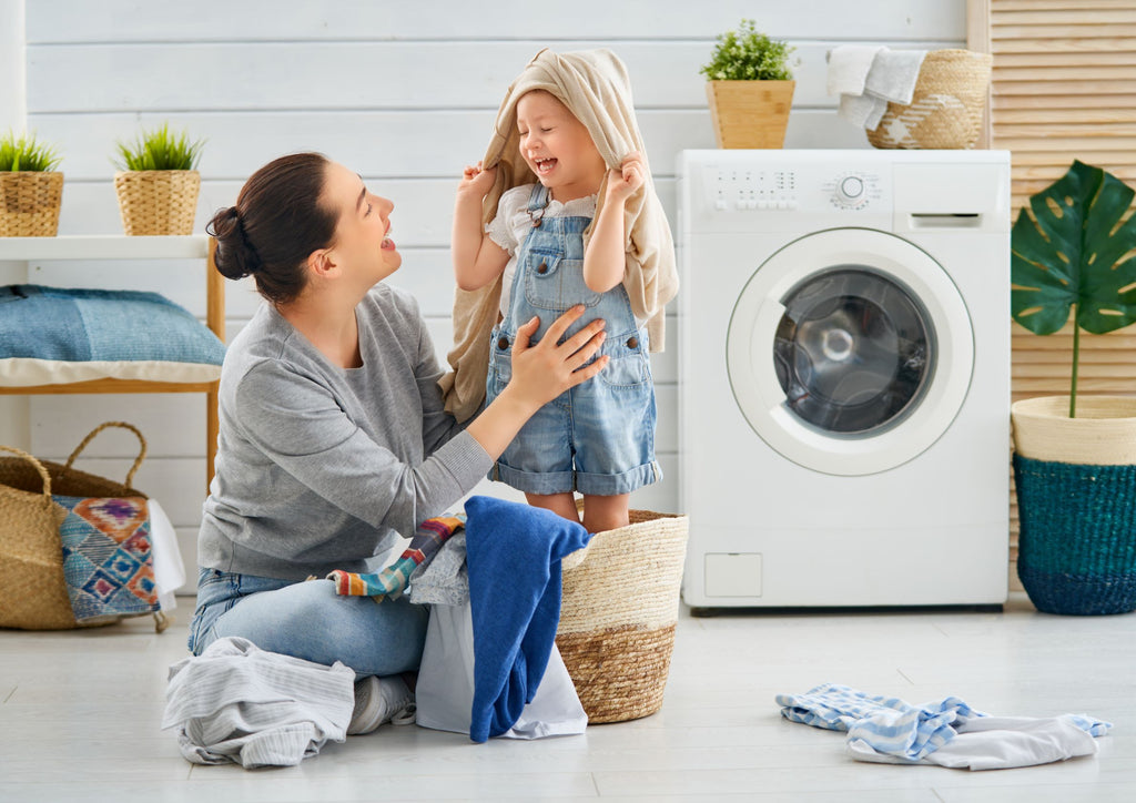 mother and child in laundry room