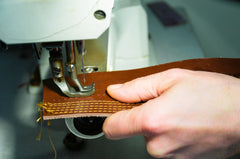 Sewing machine with leather shoe fabric