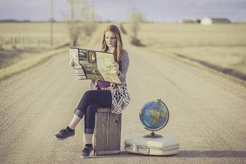Girl looking at world map to see where shoes are made around the world