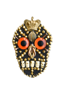 MINADEO SKULL BROOCH WITH ORANGE GLASS EYES