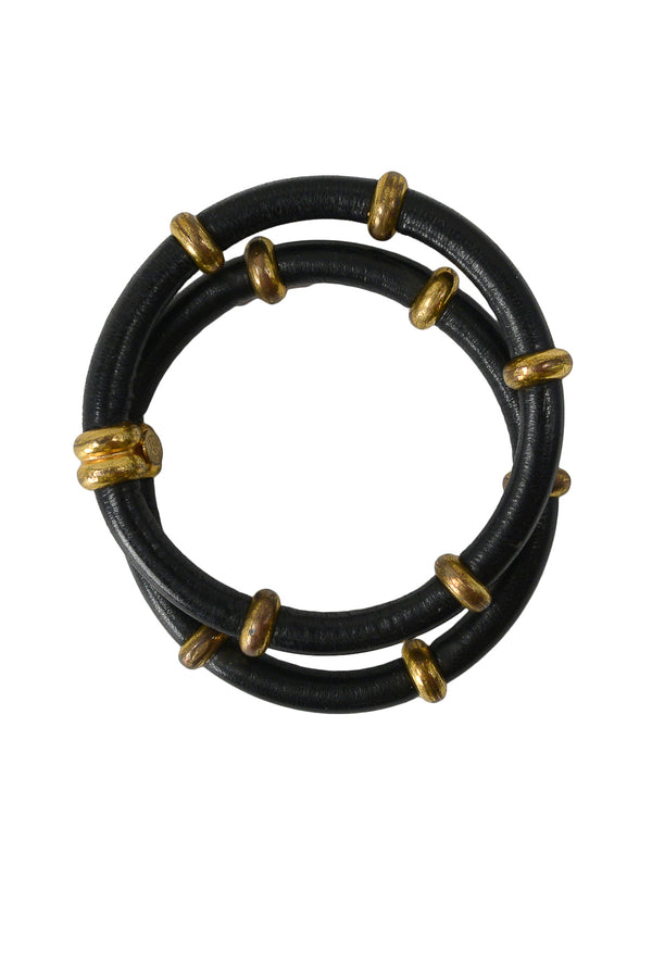 CHANEL SET OF BLACK LEATHER & GOLD TRIBAL BRACELETS