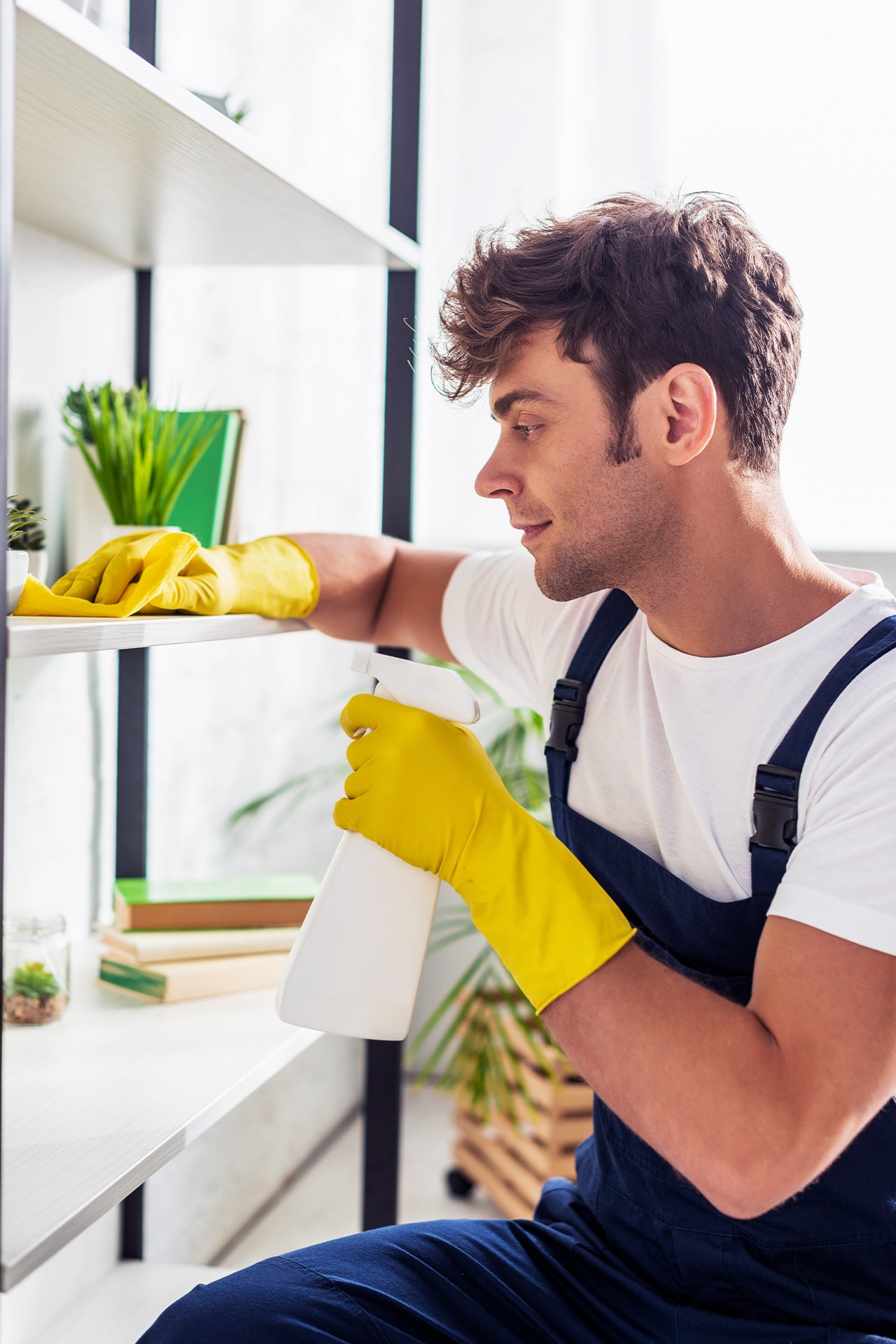 man cleaning the home