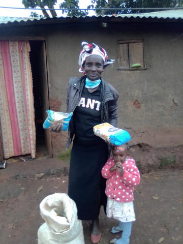 Woman in Kipsongo Slum Receiving food