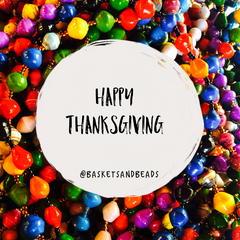 Happy Thanksgiving in a circle over colorful paper bead necklaces