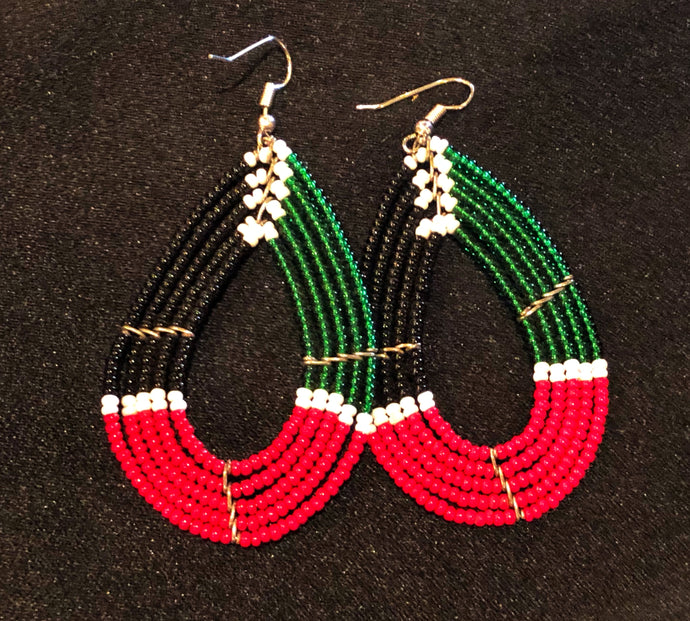 Stand out and make a statement with these stunning colorful tribal style earrings.  Traditional Kenya style earrings crafted from seed beads.  Pierced. Multi color tribal style beaded earrings.