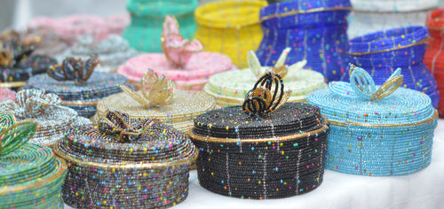 Fair Trade hand crafted basket made from seed beads. Round shape with lid. These baskets take 1 full day to create. Example photo of many baskets