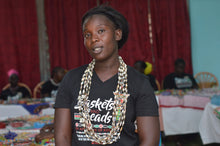 Load image into Gallery viewer, The Dorcas neckThis is Dorcas the group leader of our ladies and coordinates with our Kenya team lead Leila on orders and other business.    Your purchase empowers women like Dorcas to build a sustainable business, alleviate extreme poverty and to support her family with dignity