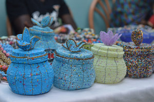 Fair Trade hand crafted basket made from seed beads in the shape of a jar with lid. Regular size baskets take at least a day to create.  Large baskets take 1 1/2 - 2 days to create.