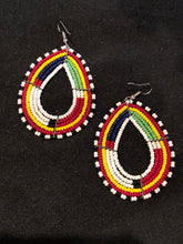 Load image into Gallery viewer, Stand out and make a statement with these stunning colorful tribal style earrings.  Traditional Kenya style earrings crafted from seed beads.  Pierced. Multi color tribal style beaded earrings.