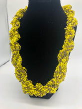 "Load image into Gallery viewer, Stand out in style with this beautiful hand made braided style beaded necklace.  Approximately 18"" end to end.   The Dorcas necklace is named after one of our ladies whose photo you will find within this collection. Yellow with Gold Accent Beading"