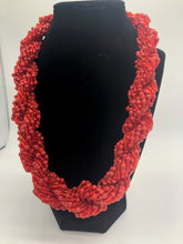 "Load image into Gallery viewer, Stand out in style with this beautiful hand made braided style beaded necklace.  Approximately 18"" end to end.   The Dorcas necklace is named after one of our ladies whose photo you will find within this collection. Red"
