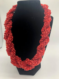 "Stand out in style with this beautiful hand made braided style beaded necklace.  Approximately 18"" end to end.   The Dorcas necklace is named after one of our ladies whose photo you will find within this collection. Red"