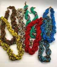 "Load image into Gallery viewer, Stand out in style with this beautiful hand made braided style beaded necklace.  Approximately 18"" end to end.   The Dorcas necklace is named after one of our ladies whose photo you will find within this collection."