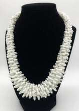 "Load image into Gallery viewer, Stand out in style with this beautiful handmade loop bead style necklace.  Hover over the photo to see the detail of how the beads are made into a loop design.  Thoughtfully designed for style and stand out fashion. Approximately 18"" end to end.  White with silver bead accent"