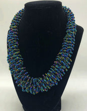 "Load image into Gallery viewer, Stand out in style with this beautiful handmade loop bead style necklace.  Hover over the photo to see the detail of how the beads are made into a loop design.  Thoughtfully designed for style and stand out fashion. Approximately 18"" end to end. slate blue multi"