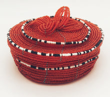 Load image into Gallery viewer, Fair Trade hand crafted basket made from seed beads. Round shape with lid. These baskets take 1 full day to create.  Red color