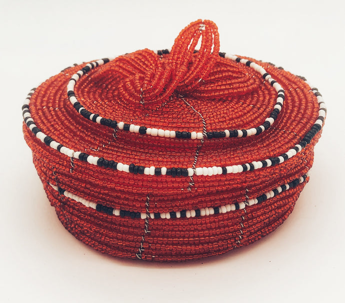 Fair Trade hand crafted basket made from seed beads. Round shape with lid. These baskets take 1 full day to create.  Red color