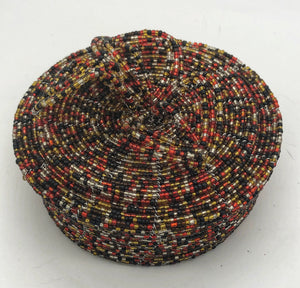 Fair Trade hand crafted basket made from seed beads. Round shape with lid. These baskets take 1 full day to create. Gold and black multi