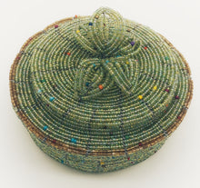 Load image into Gallery viewer, Fair Trade hand crafted basket made from seed beads. Round shape with lid. These baskets take 1 full day to create.  Pale green with gold accent around edge