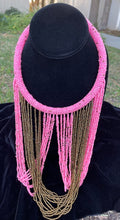 Load image into Gallery viewer, Pink and gold necklace hanging on bust. Chocker with long strands of pink and gold beads hanging down and looping back to connect to choker.