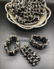 Load image into Gallery viewer, Hand crafted faded/weathered black paper bead stretch bracelet made from magazines and each bead individually rolled by hand.  Stylish and Fashionable for casual or dressy. Fair trade.