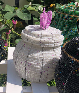 Fair Trade hand crafted basket made from seed beads in the shape of a jar with lid. Regular size baskets take at least a day to create.  Large baskets take 1 1/2 - 2 days to create. white color