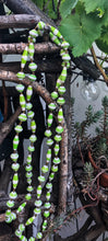 Load image into Gallery viewer, Handmade long length multicolor necklace made from magazines with accent seed beads in between. Each bead is hand rolled.Green and white pictured