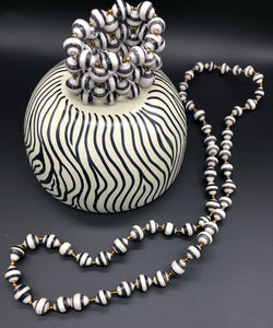 "Hand crafted black and white medium length necklace and stretch bracelet set.  Approximately 18"" Long. Made from magazines. Each bead individually rolled by hand.  Stylish and Fashionable for casual or dressy. Fair trade."
