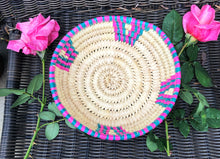 Load image into Gallery viewer, Hand woven fair trade African baskets from Kenyan grown papyrus reed natural color with pink and teal embellishment woven into the design