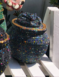 Fair Trade hand crafted basket made from seed beads in the shape of a jar with lid. Regular size baskets take at least a day to create.  Large baskets take 1 1/2 - 2 days to create. Slate blue color