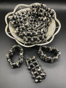 Hand crafted faded/weathered black paper bead stretch bracelet made from magazines and each bead individually rolled by hand.  Stylish and Fashionable for casual or dressy. Fair trade.