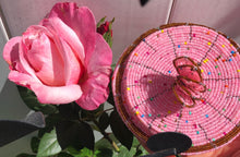 Load image into Gallery viewer, Fair Trade hand crafted basket made from seed beads. Round shape with lid. These baskets take 1 full day to create.  Rich Pink